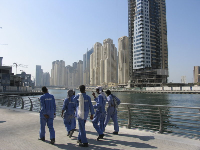 Dubai construction workers, 2008. Photo by Paul Keller via Wikimedia (CC BY 2.0)