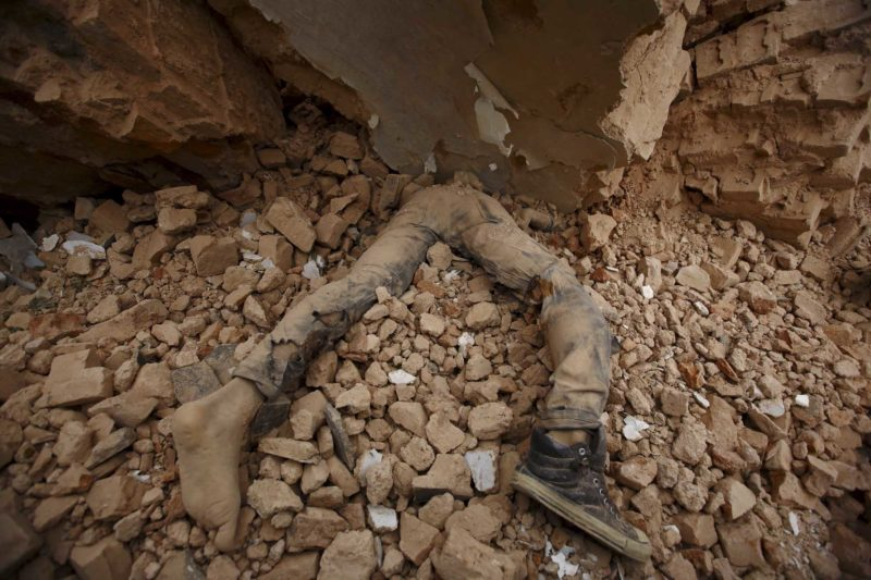 A body of a victim lies trapped in the debris after an earthquake hit, in Kathmandu, Nepal April 25, 2015. The shallow earthquake measuring 7.9 magnitude struck west of the ancient Nepali capital of Kathmandu on Saturday, killing around 9,000 people. Image by Navesh Chitrakar. Used with permission.