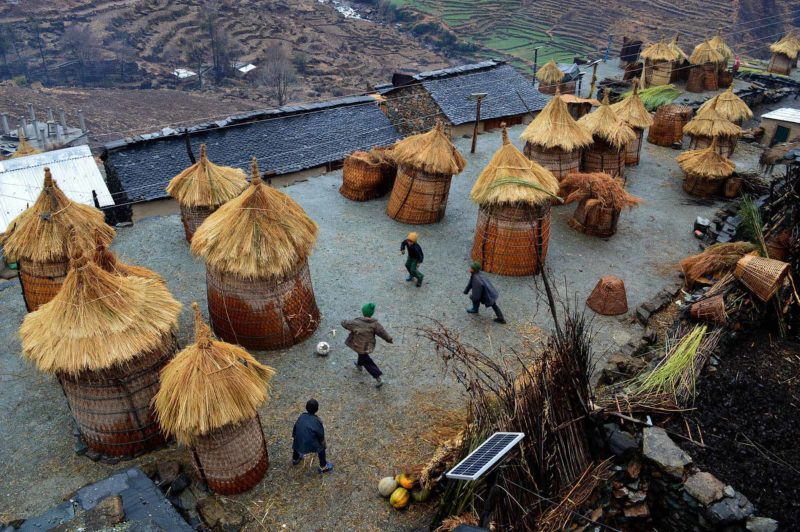 Local children playing football on the roof of a traditional house in Rukum's Taksera Village Development Committee. Since the hilly area with steep land lacks playgrounds, the children use the rooftops as an alternative. 1st in the category sports. Image by Surbindra Kumar Pun. Used with permission.