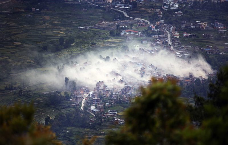 Smoke and dust billow over the sky in Khokana village of Lalitpur district a couple of minutes after Nepal was hit by a devastating earthquake on Saturday, April 25, 2015. [This caption has been abridged.] Image by Rajesh Gurung. Used with permission.