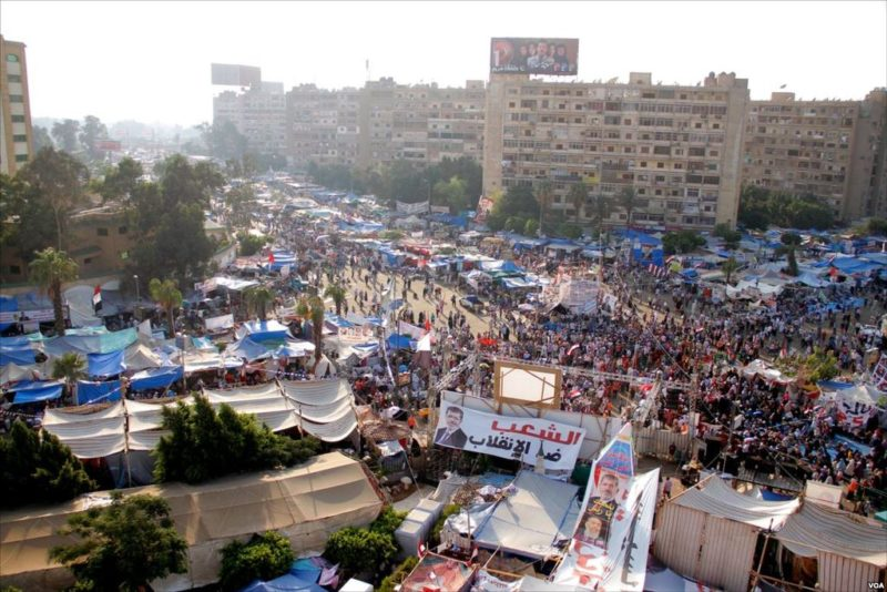 The area around the Rabaa Adiweya mosque on August 1. The area was packed with Muslim Brotherhood supporters who had been sleeping in tents for over a month. Families brought children to protect them from the police forcibly dismantling the sit-in. PHOTO: H. Elrasam for Voice of America, via Wikimedia Commons