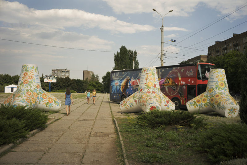 Tetrapods, normally used to build piers, have been used in Mariupol's defense, and today are found around the city decorated with Ukrainian folk symbols. Mariupol, Ukraine, July 4, 2016. Photo: Ivan Sigal