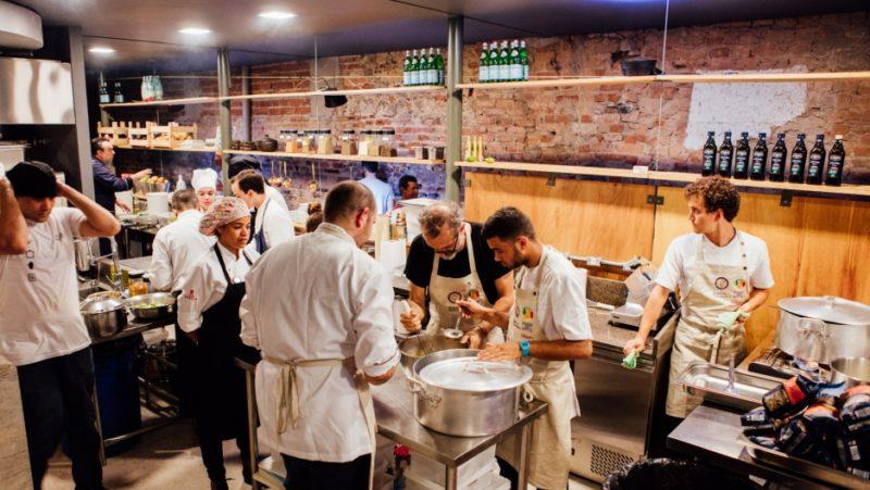 The RefettoRio team of chefs in action in Rio. Credit: Angelo DalBo/Refettorio Gastromotiva