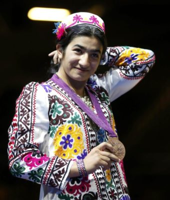 Mavzuna Chorieva during the awarding ceremony wore Tajik national clothe. The picture is taken from girlboxing.org