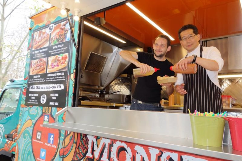 Hong Kong secretary of commerce, Gregory So visiting a food truck in Australia last August. Photo from Gregory So's Facebook via HKFP.