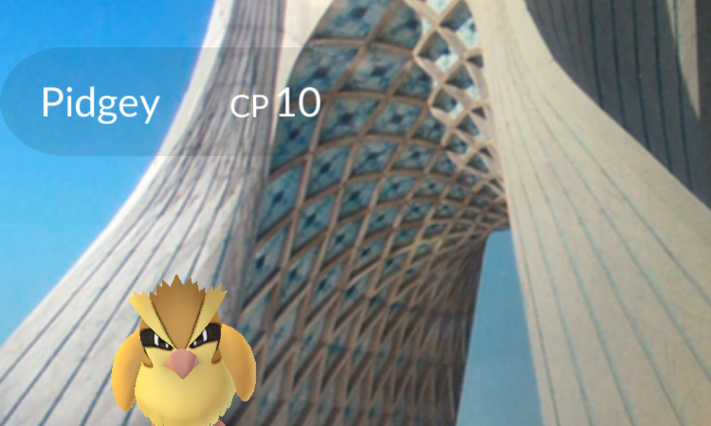Mahsa Alimardani imagines playing Pokémon Go in Tehran, holding the game up to a picture of Azadi Tower.