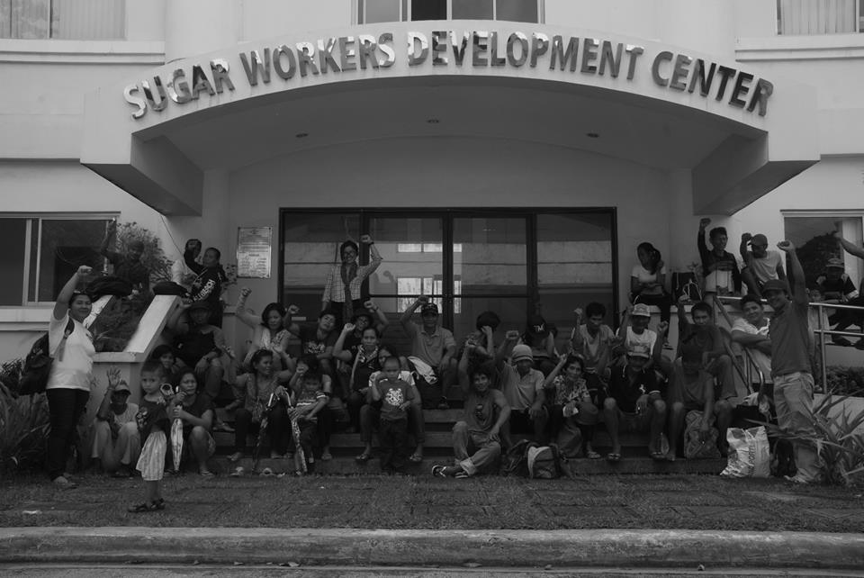 Farmers hold a protest action in front of a government agency to demand the release of calamity funds. Photo courtesy of UMA Pilipinas