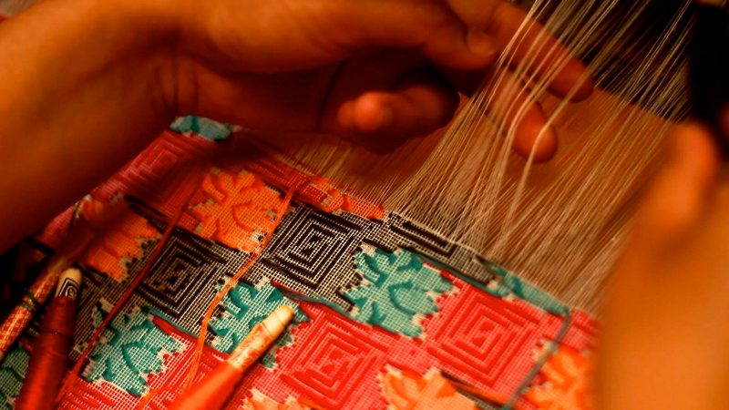 Handwoven dhaka fabric in Nepal. Image from Flickr by Oxlaey.com . CC BY 2.0
