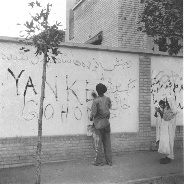 "A resident of Tehran washes ""Yankee Go Home"" graffiti from a wall in the capital city of Iran, Aug. 21, 1953. The new Premier Gen. Fazlollah Zahedi requested the clean-up after the coup d'etat which restored the Shah of Iran in power. (AP Photo) PHOTO: Pahlavi Dynasty via Wikimedia Commons"
