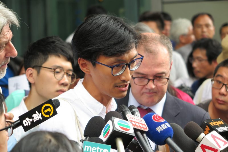 Eddie Chu talked to the press before he reported the death threat to the police. Photo from inmediahk.net.