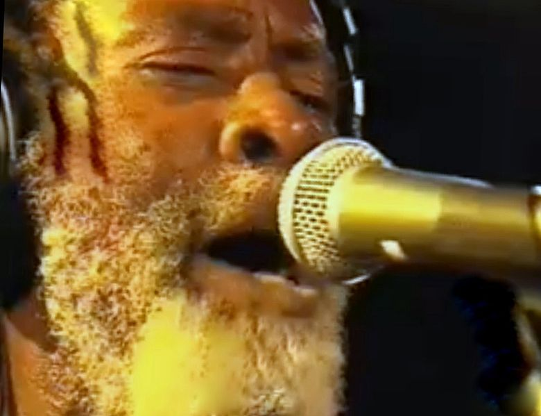 "Reggae icon Winston Rodney, alias Burning Spear, helped to keep Garvey's name in the public consciousness through his music, including the album ""Garvey's Ghost."" Photographed live at Slim's in San Fransisco. Shot from camcorded videofilm 29-30 September 2008 by user Caspiax. Public Domain. Source: Wikimedia Commons"