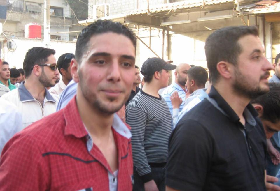 Widely shared image of Ghiath Matar (left) and Yahya Sherbaj (right) at protests in 2011. Source.