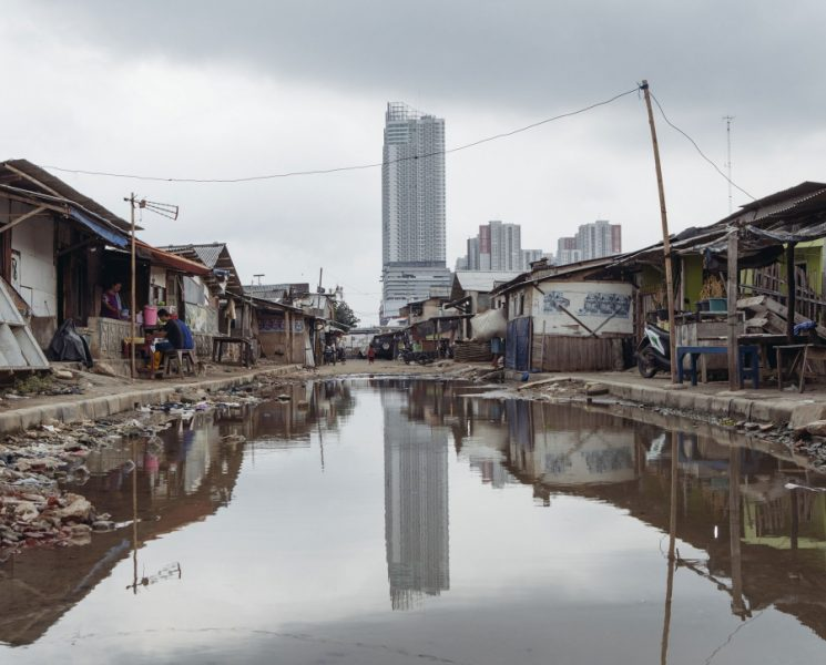 Seawater floods some streets in Jakarta's Muara Angke neighborhood even during low tides and the dry season. Most of the district's residents are fishermen who work in nearby Jakarta Bay. Credit: Muhammad Fadli/GroundTruth