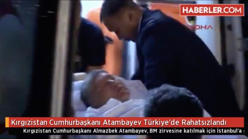 Atambayev being loaded into an ambulance from Istanbul's Ataturk airport. Screenshot from Turkey's TDA news agency.