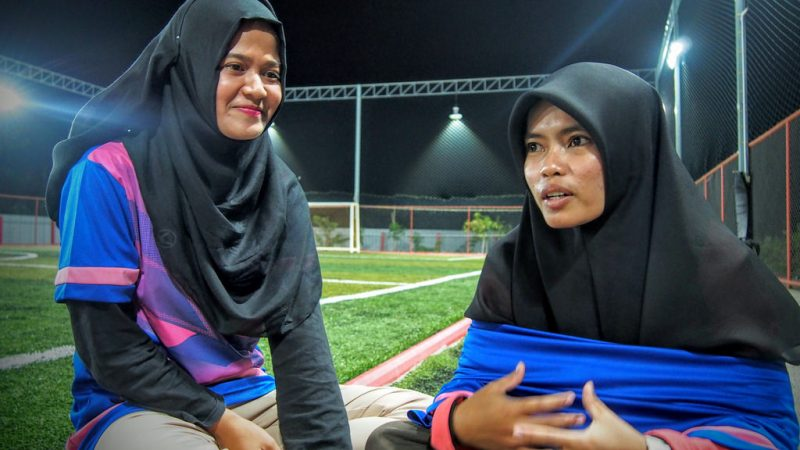 Waeasmir Waemano and Sawani Mama, students at the Pattani campus of Prince of Songkla University, say that they want society to see that women can play football, and do so even while wearing hijabs. Photo by Fadila Hamidong, courtesy of Prachatai
