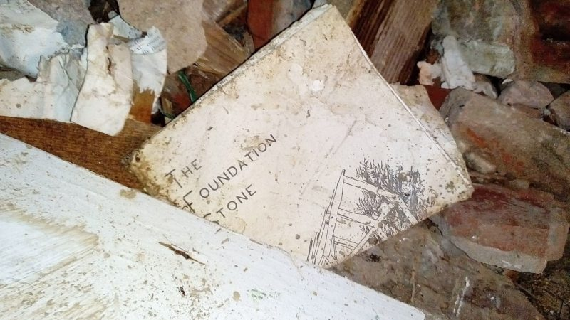 """The Foundation Stone"" -- part of the debris left behind at McBurnie's demolished residence. Photo by Rubadiri Victor, used with permission."