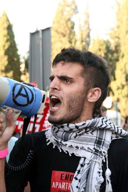 Renen Raz at a protest in Israel-Palestine. Photo uploaded by Ronnie Barkan. Source.
