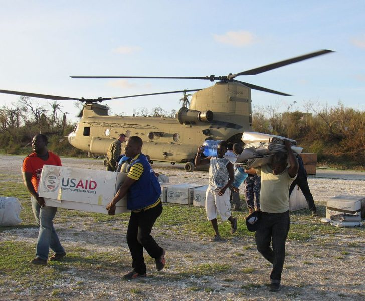 Service members from Joint Task Force Matthew and representatives from the United States Agency of International Development delivered relief supplies to areas affected by Hurricane Matthew to Jeremie, Haiti. Photo via the official U.S. Navy Page, from United States of America Capt. Tyler Hopkins/U.S. Navy [Public domain], via Wikimedia Commons