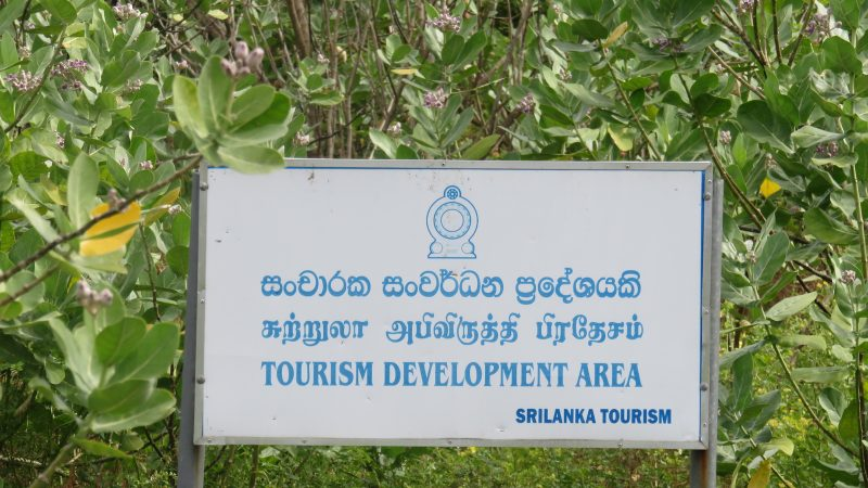 Board declaring the Tourism Zone in Kuchchaveli. Image via Groundviews.