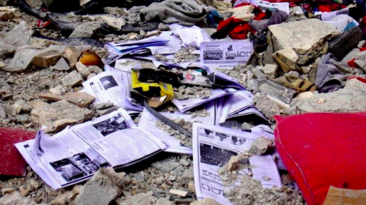 Copies of Enab Baladi on the floor after regime soldiers destroyed their office. Image source: Raw in War.