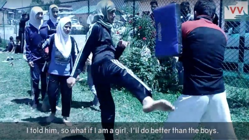Girls practicing kickboxing in Kashmir.
