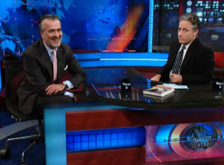 Hooman Majd on Daily Show in 2008, discussing life for Iranians after returning to the U.S. from Iran. Screenshot from Comedy Central Daily Show archives.