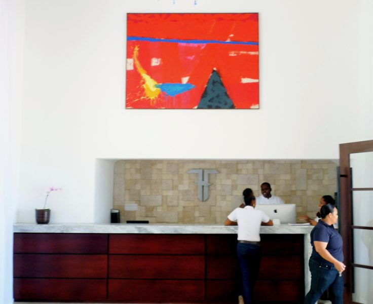 The reception area of the Trident Hotel in Port Antonio, Jamaica, displaying one of Stanley's paintings. This particular hotel owns 22 pieces of Stanley's work. Photo courtesy the artist, used with his permission.