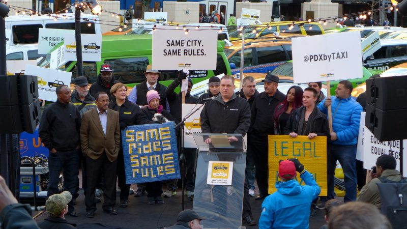 In an Uber protest in Portland, Oregon in 2015, organizers pressed for city leaders to make ride-sharing companies play by the same rules as cabs and Town cars. PHOTO: Aaron Parecki (CC BY 2.0)
