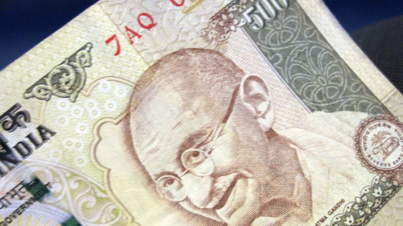 Indian Rupee 500 with the image of Mahatma Gandhi. Photo from Flickr by Marissa Garza. CC BY-NC 2.0