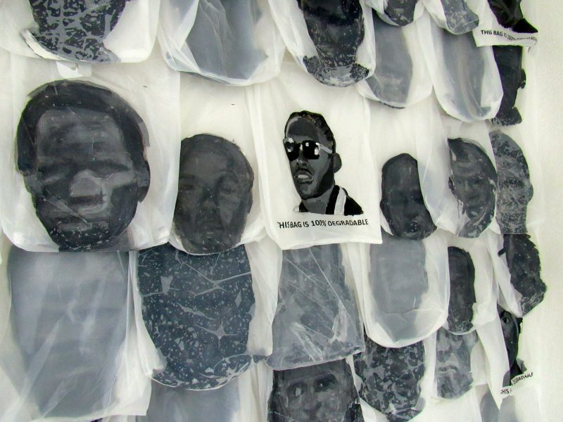 An art installation by Camille Chedda showing the faces of young men killed by the police in Jamaica. The piece was exhibited at an event hosted by the lobby group, Jamaicans for Justice, on November 23, 2016. Photo by the author, used with permission.