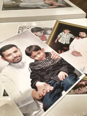 Photos of Fadhel al-Shoulah and his son. Picture shared by his wife Hajar Ali on Twitter