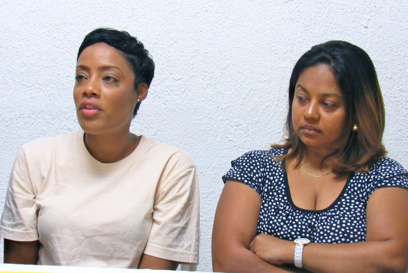 Shackelia Jackson (left) and Simone Grant at a community meeting following the release of Amnesty International's report on extrajudicial killings in Jamaica. Jackson's brother Nakeia was cooking in his kitchen on Orange Street, Kingston in January 2014, when he was killed by police; Grant's brother, Matthew Lee, and two other young men were shot dead by the police while driving in Arcadia, Kingston, in January 2013. Photo by the author, used with permission.