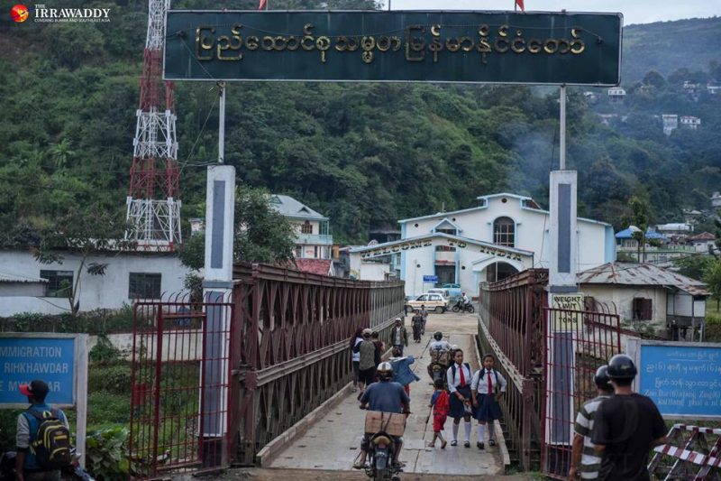 School children go back to Myanmar across the border bridge before it closes. Photo and caption: Pyay Kyaw / The Irrawaddy