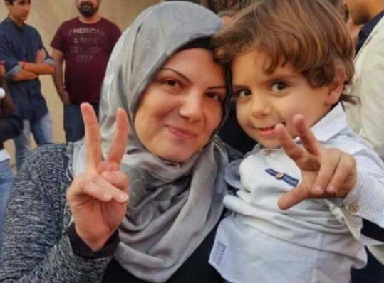 Fatima and her son Ali. Photo by 'Protecting Lebanese Women' on Facebook.