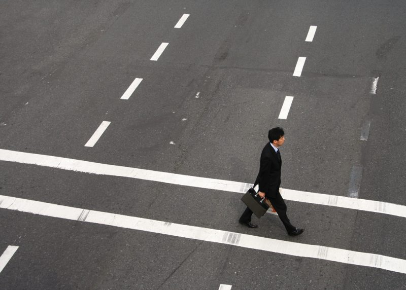 A salaryman crosses the street