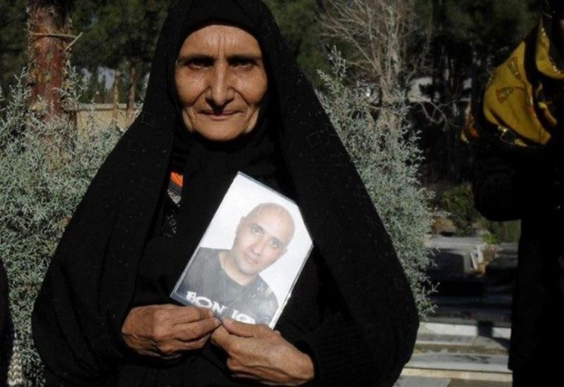 Sattar Beheshti's mother, Gohar Eshghi holds a photo of her son in protest of his murder by government interrogators. Eshghi has become a symbol of resistance to Iran's repression of online freedom of expression. Photo from ICHRI.