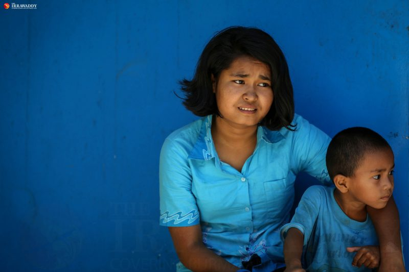 Ma Thiri Suu Kyi, 16, is seen together with her little brother Mg Zin Ko Win. She decided not to continue going to school in Yangon because she's embarrassed to be in the 7th grade with students much younger than her. Photo and caption by Hein Htet/The Irrawaddy.