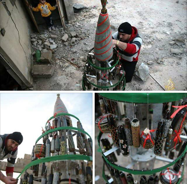 Akram Abo Alfoz decorates a Christmas tree in besieged Douma. December 24, 2016. Source.