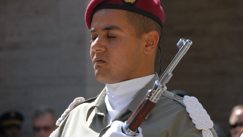 A Tunisian soldier closes his eyes in prayer during a May 31, 2010, Memorial Day ceremony at the North Africa American Cemetery and Memorial near Carthage, Tunis. Photo by US Army Africa