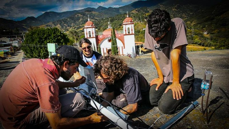 Altermundi community network collaborators work on a piece of hardware in Argentina. Photo via Altermundi blog.