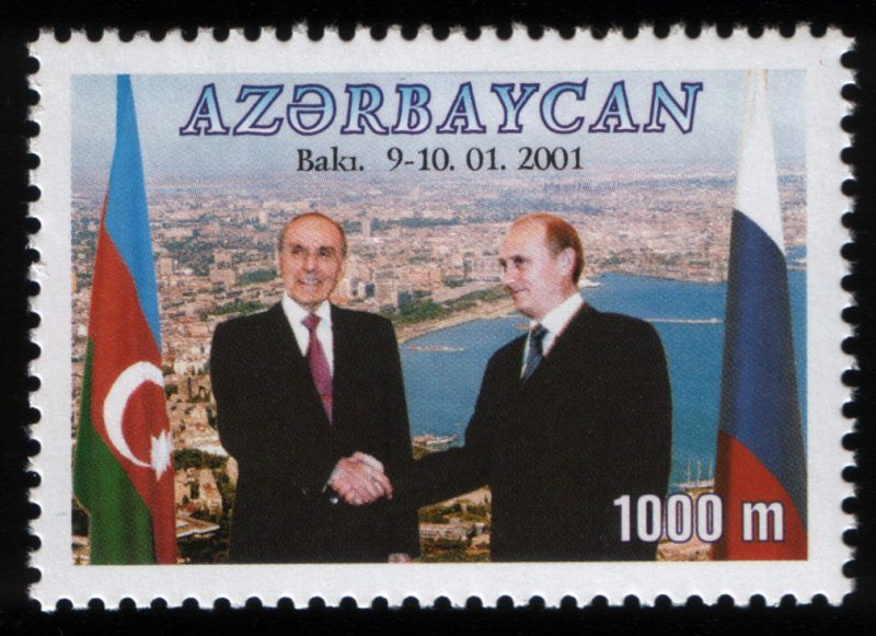 Stamp commemorating Heydar Aliyev's meeting with Russian leader Vladimir Putin in 2001. He died in late 2003. Creative commons.
