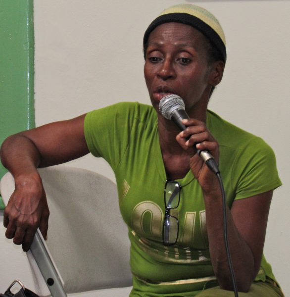 A representative of the Denham Town Community Development Centre and Justice of the Peace speaks at a Human Rights Forum in September, 2016 on the inadequate response of the police to gender-based violence. Photo by the author, used with permission.