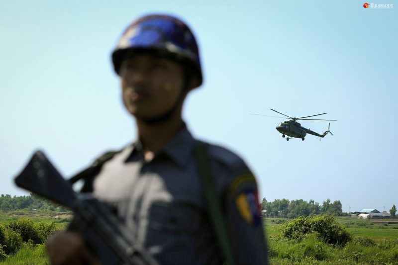 A Burmese policeman on patrol at the Myanmar-Bangladesh border fence after militants attacked border police headquarters and checkpoints in northern Arakan State's Maungdaw Township on Oct. 9. (Photo: Hein Htet / The Irrawaddy)