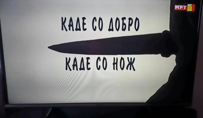 "A frame from the Macedonian PBS 'documentary' about Andon Kjoseto, featuring his proverb ""Sometimes you ask nicely, sometimes you use the knife."""