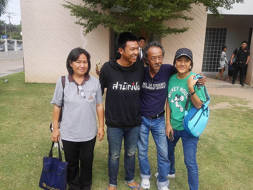 Jatuphat Boonpattaraksa (second from left) is reunited with his family after his release from detention. Photo from Prachatai