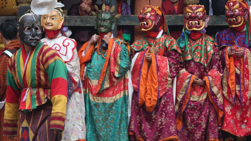 Masked dances performed in annual religious Bhutanese festival called tshechu on the tenth day of a month of the lunar Tibetan calendar. Image from Flickr by Arian Zweckers. CC BY 2.0