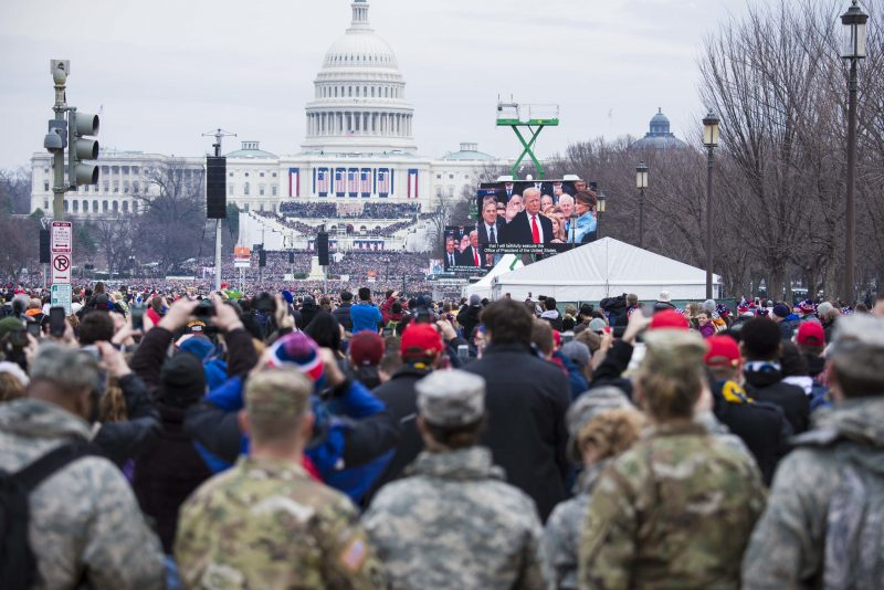 """Soldiers and Airmen from the Florida National Guard look on as President Donald Trump takes the oath of office during the 2017 Presidential Inauguration."" Photo taken from The National Guard flickr page, CC BY 2.0."