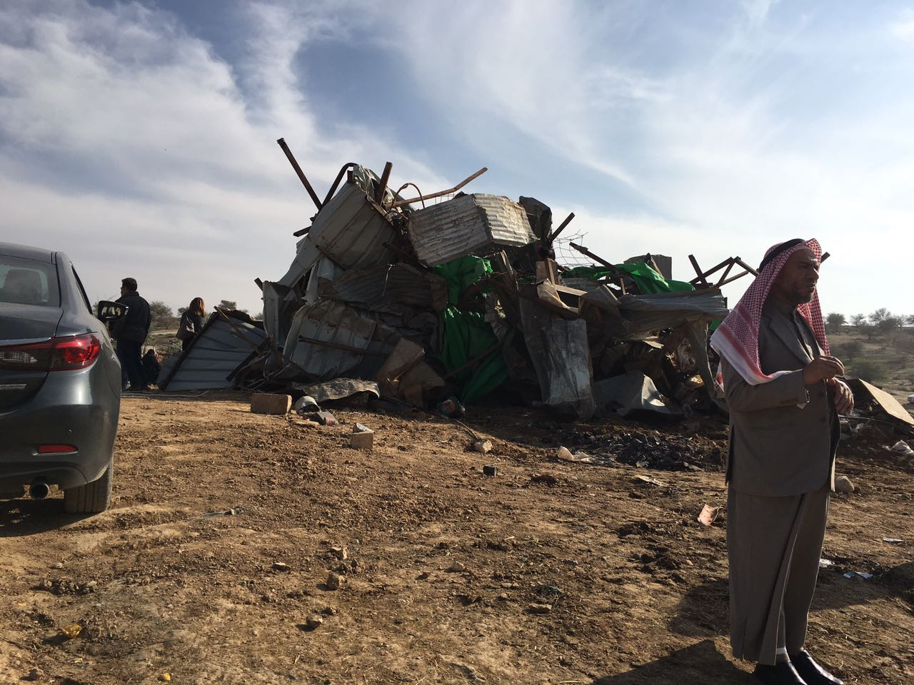 Bedouin man standing by a destroyed home in Umm el-Hiran village. Wednesday January 18, 2016. Source: Global Voices