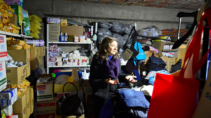 Lenče Zdravkin turned the ground floor of her house into a storeroom for humanitarian aid handed to passing refugees and migrants. Photo by Viktor Popovski/IKS, CC BY-NC-ND 3.0