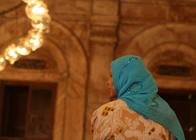 "Woman in Alabaster Mosque of Mohamed Ali in Cairo. <a href=""https://commons.wikimedia.org/wiki/File:Flickr_-_DavidDennisPhotos.com_-_Woman_in_Alabaster_Mosque_of_Mohamed_Ali_in_Cairo.jpg"">Source: WikiCommons.</a>"